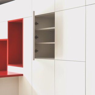 Inspiration for a modern l-shaped breakfast bar in Nantes with white cabinets, laminate countertops and vinyl flooring.