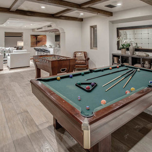 Inspiration for a mediterranean medium tone wood floor basement remodel in Los Angeles with white walls
