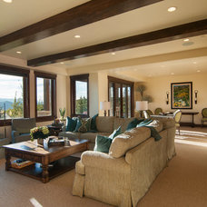 Rustic Basement by Cameo Homes Inc.