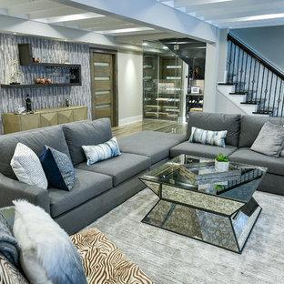 Idée de décoration pour un grand sous-sol design donnant sur l'extérieur avec un mur gris, un sol en vinyl, une cheminée ribbon, un manteau de cheminée en carrelage et un sol gris.