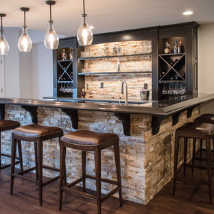Inspiration for a large classic walk-out basement in Louisville with beige walls, medium hardwood flooring, a standard fireplace, a brick fireplace surround and brown floors.