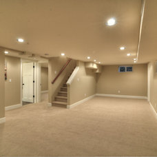 Traditional Basement by TTM Development Company
