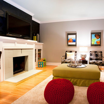 Basement - contemporary underground light wood floor and orange floor basement idea in Vancouver with gray walls, a standard fireplace and a tile fireplace