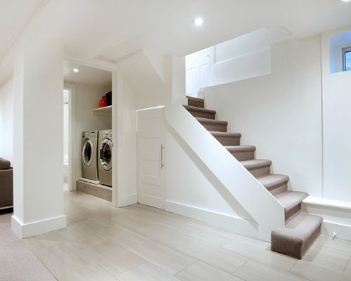 example of a small trendy look out porcelain floor basement design in toronto with white - Small Basement Design Ideas