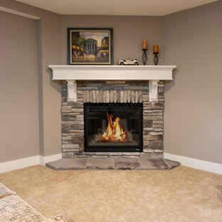 Inspiration for a large craftsman look-out carpeted basement remodel in Minneapolis with gray walls