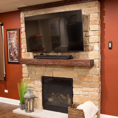 Basement - large traditional underground dark wood floor and brown floor basement idea in Chicago with beige walls, a standard fireplace and a stone fireplace