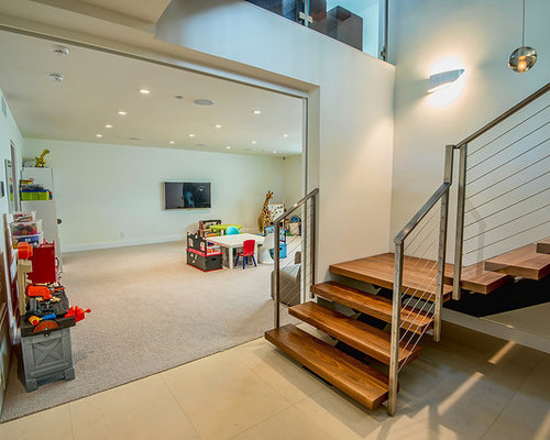 basement ideas for teenagers. Trendy look out carpeted and beige floor basement photo in Los Angeles with  white walls Playroom For Teens Basement Ideas Photos Houzz