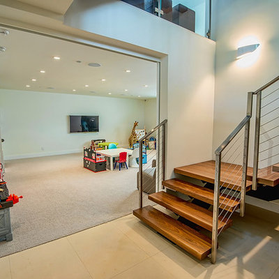 Trendy look-out carpeted and beige floor basement photo in Los Angeles with white walls and no fireplace
