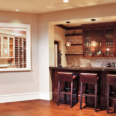 Contemporary Basement by moment design + productions, llc