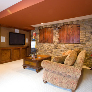 Inspiration for a mid-sized country look-out basement in Denver with red walls, carpet, no fireplace and beige floor.