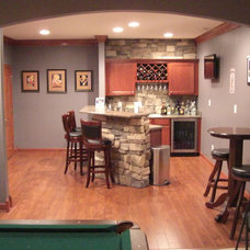 Traditional Basement by The WAIRE Group