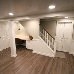 Small traditional fully buried basement in Other with beige walls, cork flooring, no fireplace and brown floors.