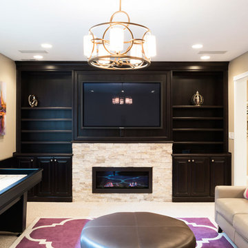 Basement Family Room with Stone Fireplace, Built-In Bookshelves, and a Game Tabl