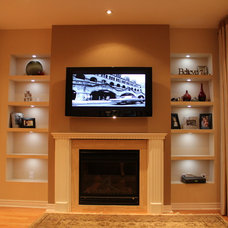 Contemporary Basement by AGM Renovations