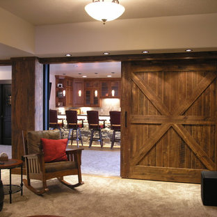 Example of a mid-sized classic carpeted and beige floor basement design in Denver with brown walls
