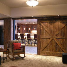 Traditional Basement by Inhabit Design Group