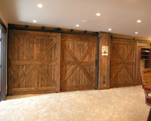 Traditional ornate double barn door basement design ideas for Basement double door