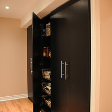 Traditional Basement by House Tune Up
