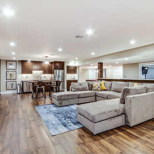 Inspiration for a large traditional fully buried basement in New York with grey walls, dark hardwood flooring and brown floors.