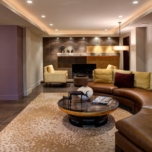 Example of a trendy underground ceramic floor basement design in Chicago with gray walls, a standard fireplace and a tile fireplace