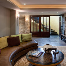 Contemporary Basement by Fredman Design Group