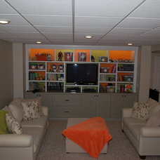 Contemporary Basement by Basement Builders of NY