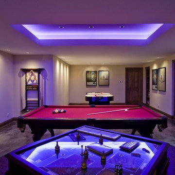 Basement Game Room with Stained Concrete Floor and Fluorescent Indirect Lighting