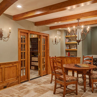 Design ideas for a mid-sized traditional look-out basement in Milwaukee with green walls, limestone floors, no fireplace and beige floor.