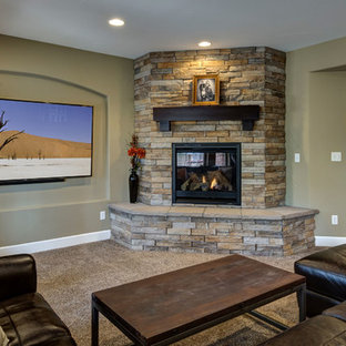 Huge transitional walk-out carpeted and brown floor basement photo in Denver with beige walls, a corner fireplace and a stone fireplace