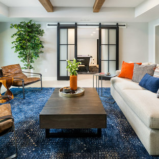 Example of a mid-sized transitional look-out light wood floor and beige floor basement design in Atlanta with gray walls and a ribbon fireplace