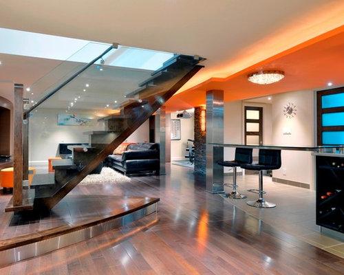 modern basement design ideas renovations photos with beige walls