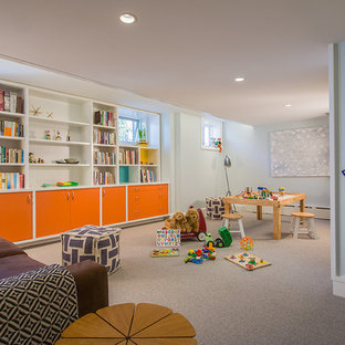 Example of a large eclectic look-out carpeted and beige floor basement design in DC Metro with blue walls