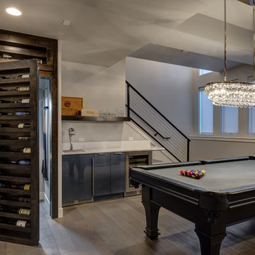 Basement Pool Table and Hidden Bookcase Wine Rack