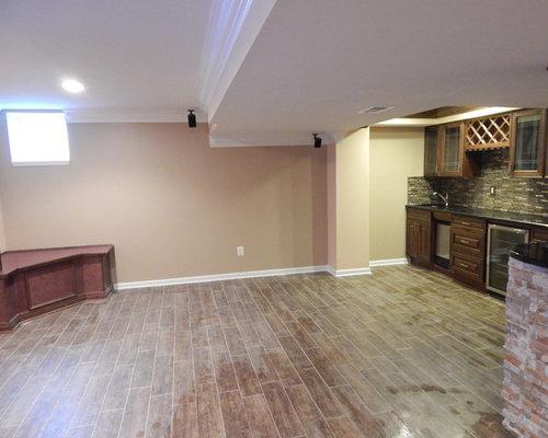 modern basement design ideas pictures remodel decor with ceramic floors. Black Bedroom Furniture Sets. Home Design Ideas