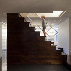 Modern Basement by Hurst Construction, Inc