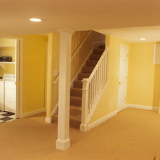 Traditional Basement by Houseworks Unlimited, Inc.