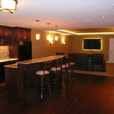 Transitional Basement by Northwest Lighting and Accents