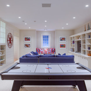 Example of a large beach style look-out carpeted and white floor basement design in Boston with white walls and no fireplace
