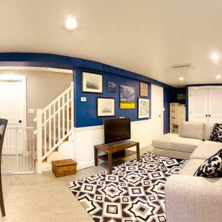 Réalisation d'un sous-sol tradition enterré et de taille moyenne avec un mur bleu, un sol en linoléum, aucune cheminée et un sol gris.