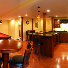 Traditional Basement by Village Construction