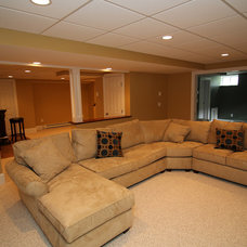 Traditional Basement by RemodelWerks LLC