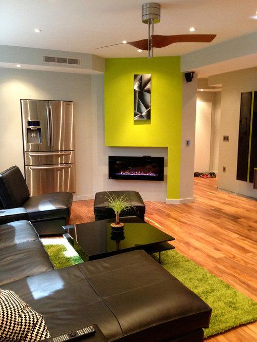 Contemporary Medium Tone Wood Floor And Orange Basement Idea In Atlanta With Green Walls