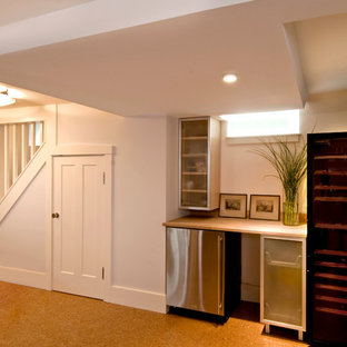 Photo of a contemporary look-out basement in Boston with white walls and cork flooring.
