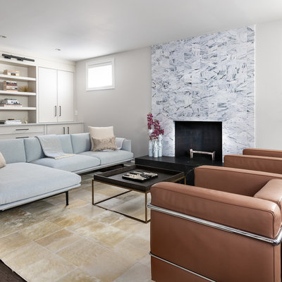 Example of a mid-sized trendy walk-out dark wood floor and brown floor basement design in DC Metro with white walls, a standard fireplace and a brick fireplace