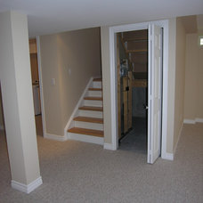 Traditional Basement by Castle Ridge Construction Inc.