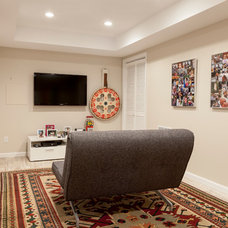 Contemporary Basement by Simply Baths & Showcase Kitchens