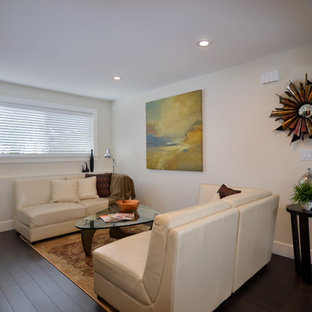 Basement - contemporary look-out dark wood floor and brown floor basement idea in Vancouver with beige walls and no fireplace