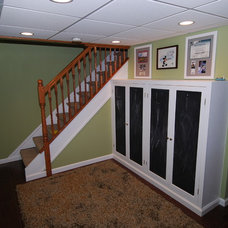 Traditional Basement by Taitco & Tait Roofing, Inc