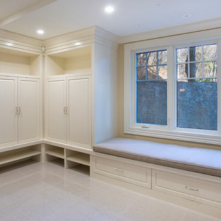 Inspiration for a large timeless walk-out marble floor basement remodel in Calgary with beige walls and no fireplace