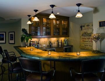 Basement Wet Bar with Glass Panel Cabinets and Wine Barrel Countertop